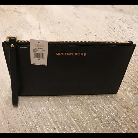 Michael Kors Handbags - MICHAEL KORS leather pouch .